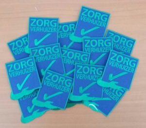 Badges Zorgverhuizer Mondial Movers